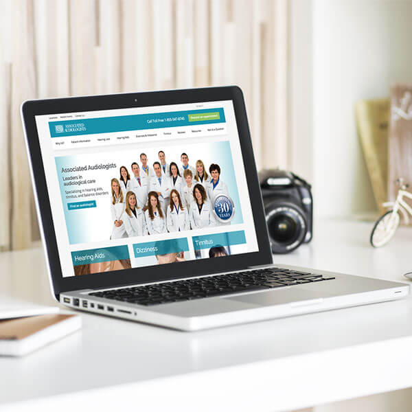 Associated Audiologists Website On A Laptop Featured Image